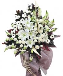 Giỏ hoa tang lễ trở về cát bụi